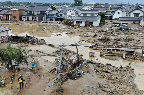 Zerstörerischer Taifun Hagibis: Die WM in Japan wurde zwischenzeitlich massiv von Taifun Hagibis bedroht. Deshalb mussten drei Gruppenspiele abgesagt werden. Japan beklagt bis heute über 70 Todesopfer und zahlreiche Verletzte. Unzählige Menschen verloren ihr Zuhause.(Bild: Kyodo News via AP)