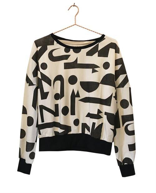 Bauhaus zum Anziehen: Fair produzierter Pullover mit Print, bei Komana, 135 Franken.