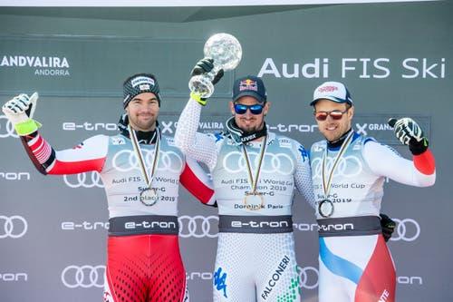 Dominik Paris (Mitte) vor Vincent Kriechmayr (links) und Mauro Caviezel. (Bild: Christian Bruna / EPA)