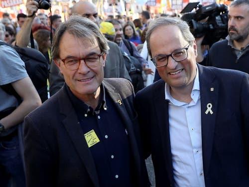 Trugen den Protest der katalanischen Unabhängigkeitsbefürworter erstmals in die Hauptstadt Madrid: Quim Torra (rechts), Präsident des katalonischen Regionalparlaments, und sein Vorgänger Artur Mas (links). (Bild: KEYSTONE/EPA EFE/J.J GUILLEN)