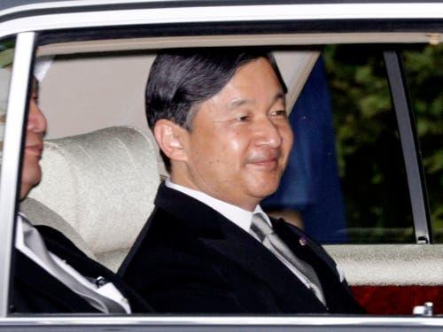 Am Mittwoch wird der ältestes Sohn des japanischen Kaisers Akihitos, Kronprinz Naruhito, den Thron besteigen und so eine neue Ära für das asiatische Land einläuten. (Bild: KEYSTONE/AP Kyodo News/HIROKO HARIMA)