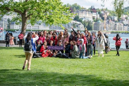 Posieren auf dem Inseli mit der Luzerner Kulisse im Hintergrund. (Bild: Urs Flüeler / Keystone, Luzern, 13. Mai 2019)