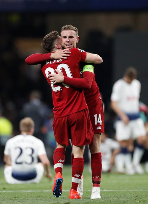 Liverpool's Adam Lallana, left and Jordan Henderson celebrate at the end of the Champions League final soccer match between Tottenham Hotspur and Liverpool at the Wanda Metropolitano Stadium in Madrid, Saturday, June 1, 2019. (AP Photo/Bernat Armangue)