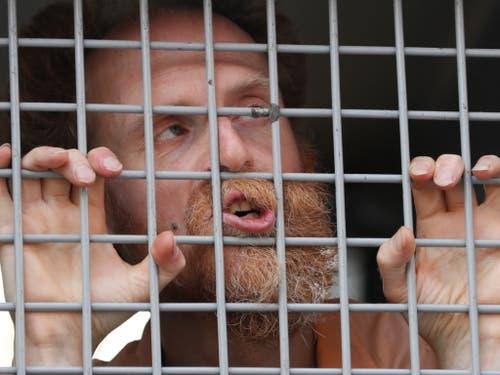 Einer der festgenommenen Oppositionellen, die am Samstag an einer unbewilligten Kundgebung in Moskau teilgenommen haben. (Bild: KEYSTONE/EPA/YURI KOCHETKOV)
