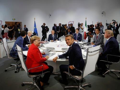 Die deutsche Bundeskanzlerin Angela Merkel (l.), Frankreichs Premierminister Emmanuel Macron (2. v. l.), US-Präsident Donald Trump (r.) und Japans Premierminister Shinzo Abe (2. v. r.) am G7-Gipfel in Biarritz. (Bild: KEYSTONE/AP POOL Reuters/PHILIPPE WOJAZER)